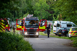 © Licensed to London News Pictures. 23/06/2020. Cookham, UK. Emergency vehicles at a rendezvous point close to the River Thames. A search and rescue operation was launched Tuesday evening after reports that several people, believed to be refugees from Syria, got into difficulties, it is understood that one person was rescued and transferred to hospital and one person remained unaccounted for. Multiple emergency resources were deployed to the scene, close to Odney Common in Cookham, including lowland search and rescue teams. Photo credit: Peter Manning/LNP