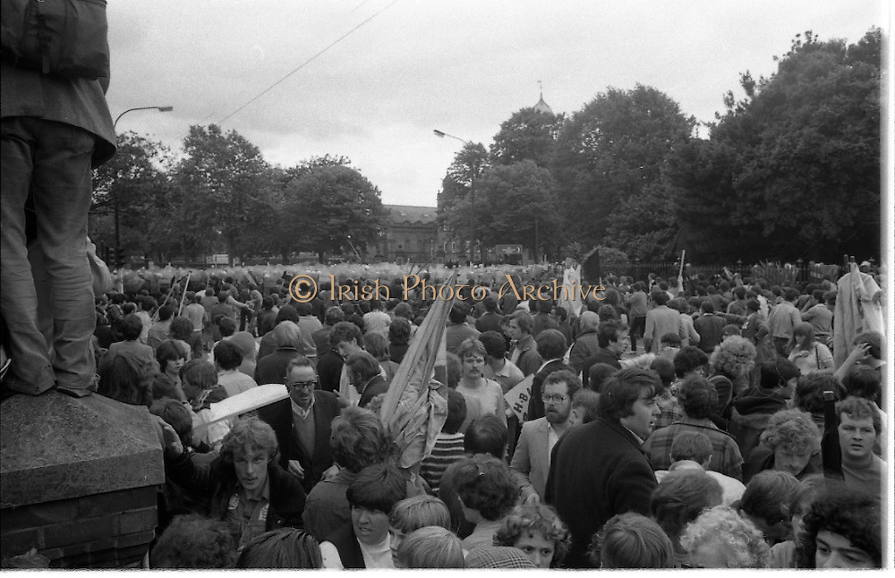 H-Block Protest To British Embassy.  (N86)..1981..18.07.1981..07.18.1981..18th July 1981..A protest march to demonstrate against the H-Blocks in Northern Ireland was held today in Dublin. After the death of several hunger strikers in the H-Blocks feelings were running very high. The protest march was to proceed to the British Embassy in Ballsbridge...Gardaí hold the line as trouble flares, many of the cowd who were trapped in the crush have managed to escape the ensuing panic.