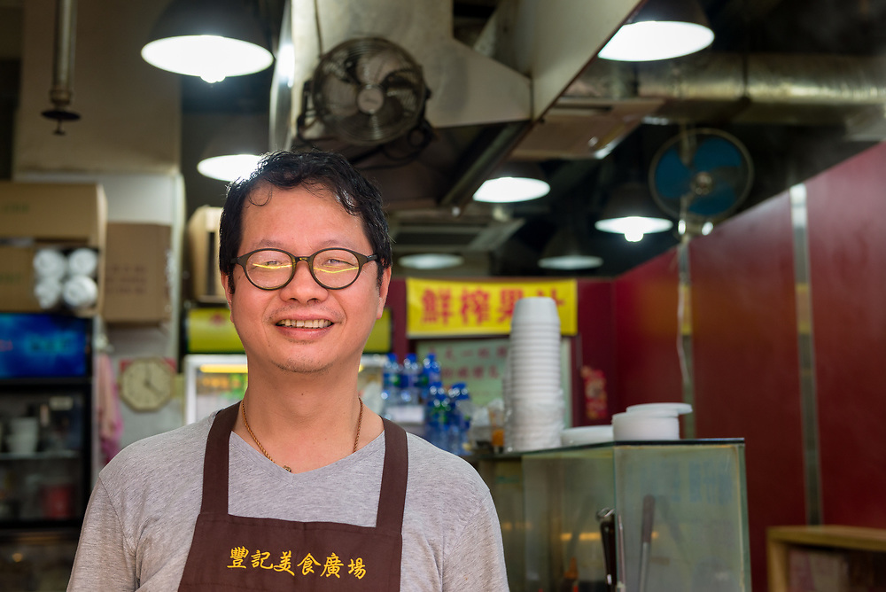 Smiling cafe owner in Central district of Hong Kong