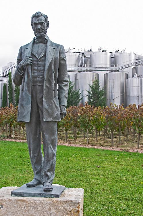 Fermentation tanks. Bronze sculpture of Abraham Lincoln by Charles Keck.  Bacalhoa Vinhos, Azeitao, Portugal
