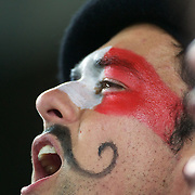 A french fan sings the National Anthem during the New Zealand V France, Pool A match during the IRB Rugby World Cup tournament. Eden Park, Auckland, New Zealand, 24th September 2011. Photo Tim Clayton...