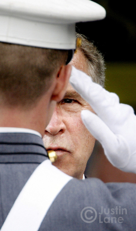 United States President George W. Bush (R) is saluted by a cadet after delivering the commencement address during graduation ceremonies at the United States Military Academy in West Point , NY on Saturday 27 May 2006.