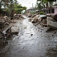 A street is filled with mud and and destroyed furniture in La Planeta, San Pedro Sula, Honduras.<br /> <br /> Hurricanes Eta and Iota hit hard on the north coast of Honduras, leaving some areas flooded for three weeks, destroying people's furniture, belongings, vehicles and houses as well as standing crops.