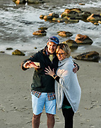 Couple posing for a selfie at the beach.