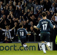 Photo: Glyn Thomas.<br />West Bromwich Albion. Newcastle Utd. The Barclays Premiership. 30/10/2005.<br /> Newcastle's Michael Owen (L) celebrates scoring in front of the away fans.