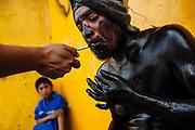 Young pintados use cigarretes and alcohol in the Carnival. SPANISH: Tabaco y alcohol son elementos habituales para los jóvenes que participan en el carnaval.