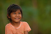 Macushi girl,<br /> Fairview Amerindian village<br /> Iwokrama Reserve<br /> GUYANA. South America<br /> Warashi is used to carry things