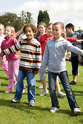 Group of children taking part in a dance workshop at a Parklife summer activities event,