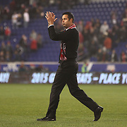 A relieved coach Mike Petke, New York Red Bulls, salutes the crowd at the end of the game after the New York Red Bulls V Sporting Kansas City, Major League Soccer Play Off Match at Red Bull Arena, Harrison, New Jersey. USA. 30th October 2014. Photo Tim Clayton