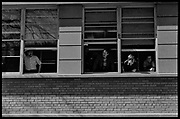 Madison, WI - March 1970. On March 15, 1970, the University of Wisconsin - Madison Teaching Assistants' Association voted to strike, and the campus was filled with picket lines as well as demonstrations of related and other issues. The strike lasted until early April, when the Association and University came to an agreement. Onlookers line campus windows for a view of the strike.