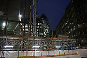 Architecture under construction near to the Gherkin in the City of London at night, England, United Kingdom.
