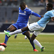 Demba Ba, Chelsea, is challenged by Dedryck Boyata, Manchester City, during the Manchester City V Chelsea friendly exhibition match at Yankee Stadium, The Bronx, New York. Manchester City won the match 5-3. New York. USA. 25th May 2012. Photo Tim Clayton