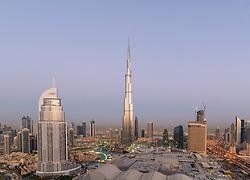 Burj Khalifa , the Dubai Mall and skyline of Downtown Dubai at sunrise in United Arab Emirates