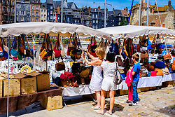 Shoppers in the market at the harbour in Honfleur, Normandy, France