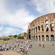 Rome's Colosseum by day with crowds of tourists