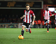 Brentford midfielder Sam Saunders dribbling during the Sky Bet Championship match between Brentford and Huddersfield Town at Griffin Park, London, England on 19 December 2015. Photo by Matthew Redman.
