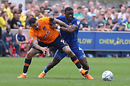 AFC Wimbledon defender Deji Oshilaja (4) battles for possession with Oldham Athletic forward Craig Davies (9) during the EFL Sky Bet League 1 match between AFC Wimbledon and Oldham Athletic at the Cherry Red Records Stadium, Kingston, England on 21 April 2018. Picture by Matthew Redman.