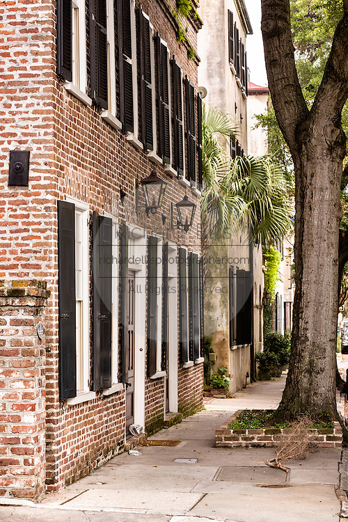 A old house on State Street with earthquake bolts called gib plates in the French Quarter of historic Charleston, SC.