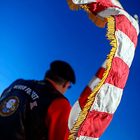 012014  Adron Gardner/Independent<br /> <br /> Edges of an American flag carried by  Phil Silva flutter in the breeze during a march east on Historic Route 66 to commemorate Martin Luther King Day in Gallup Monday.
