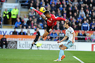 Cardiff city's Fraizer Campbell tries to get on the end of a long ball in penalty area..  Barclays Premier league, Cardiff city v West Ham Utd match at the Cardiff city Stadium in Cardiff, South Wales on Saturday 11th Jan 2014.<br /> pic by Andrew Orchard, Andrew Orchard sports photography.