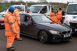 Harefield, UK. 8 February, 2020. A local motorist shows his frustration with HS2 engineers blocking access to Harvil Road. The road was blocked and the Chiltern Rail line closed in order to carry out tree felling works for the high-speed rail project. The activists were successful in preventing any of the scheduled tree felling by HS2 and after an intervention by a police officer all tree felling and strimming work has now been cancelled for the weekend.