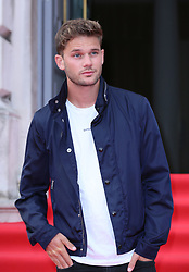 Jeremy Irvine arriving at the UK premiere of The Wife at Somerset House in London.