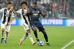 November 7, 2018 - Turin, Piedmont, Italy - Paul Pogba (Manchester Utd. FC) and Juan Cuadrado (Juventus FC) competes for the ball during the UEFA Champions League match between Juventus FC and Manchester United FC,  at Allianz Stadium on November 07, 2018 in Turin, Italy..Juventus FC lost 1-2 against Manchester United. (Credit Image: © Massimiliano Ferraro/NurPhoto via ZUMA Press)