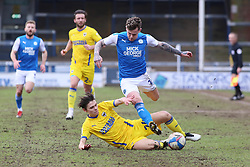 Sammie Szmodics of Peterborough United is tackled by George Dobson of AFC Wimbledon - Mandatory by-line: Joe Dent/JMP - 20/02/2021 - FOOTBALL - Weston Homes Stadium - Peterborough, England - Peterborough United v AFC Wimbledon - Sky Bet League One