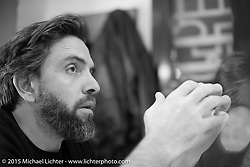 Fabrice Roux, the publisher of Freeway France and Moto Heroes Magazines in Francer, at dinner during EICMA, the largest international motorcycle exhibition in the world. Milan, Italy. November 18, 2015.  Photography ©2015 Michael Lichter.