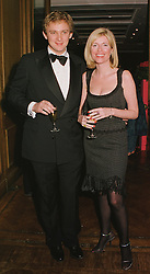 MR CHARLES THOMPSON and MISS LUCY SYKES she is the British born New York society girl, at a party in London on 22nd February 1999.MON 97