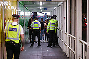 """Police are seen observing the area, meanwhile, people enjoying a late after mid-night out in Soho's 'G.A.Y., Late' in London's West End on early Monday, Sept 14, 2020. The public has been urged to act """"in tune"""" with Covid-19 guidelines as the """"rule of six"""" restrictions is into force on Monday. The British government's scientific advisory board announced on Friday that the reproduction number of coronavirus transmission across the UK was now over 1.0. The Science and the Scientific Advisory Group for Emergencies (SAGE) said the R-value was now between 1.0 and 1.2. (VXP Photo/ Vudi Xhymshiti)"""