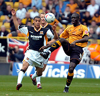 Photo: Ed Godden/Sportsbeat Images.<br />Wolverhampton Wanderers v Hull City. Coca Cola Championship. 09/04/2007. Wolves' Seyi Olofinjana (R), gets to the ball before Lee Peltier.