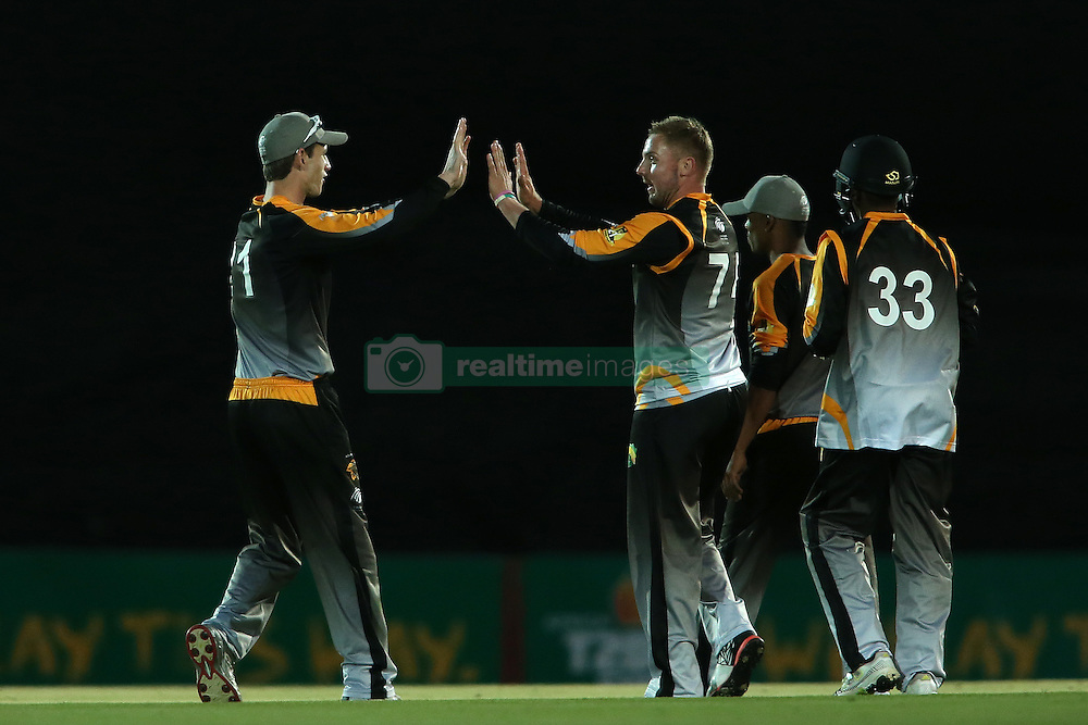 Kyle Simmonds of Boland congratulates Stiaan Van Zyl of Boland for getting Edward Moore of Eastern Province wicket during the Africa T20 cup pool D match between Boland and Eastern Province held at the Boland Park cricket ground in Paarl on the 24th September 2016.<br /> <br /> Photo by: Shaun Roy/ RealTime Images