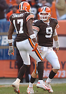MORNING JOURNAL/DAVID RICHARD.Rookies Charlie Frye, right, and Braylon Edwards celelbrate their first completion as a duo during the fourth quarter yesterday.