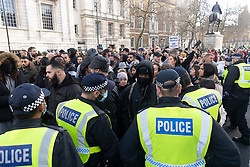 © Licensed to London News Pictures. 19/12/2020. London, UK. Protesters taking part in an anti Covid-19 lockdown demonstration remonstrate with police officers in Central London. The group against the current tier regulations and against vaccination for the Covid-19 disease. Photo credit: Ray Tang/LNP