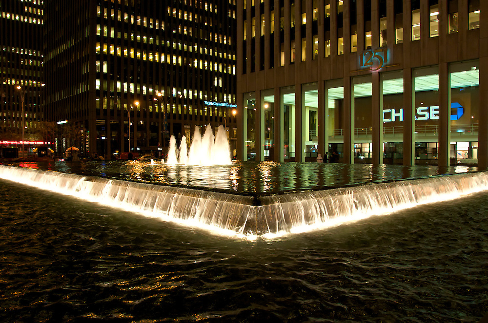 Fountain pool at the 1251 6ht. Avenue, across the Rockefeller Center in Manhattan. 1251 Avenue of the Americas rises 54 stories to 750 feet in Rockefeller Center. The building features a 112-foot-deep landscaped plaza with a large fountain pool