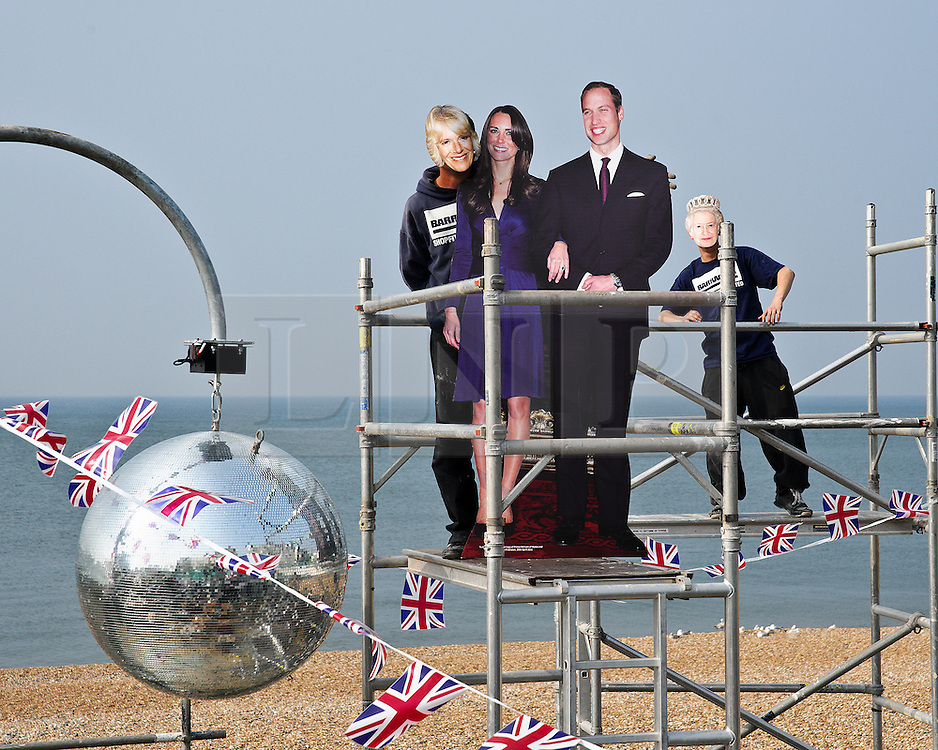 BRIGHTON, UK  29/04/2011. The Royal Wedding of HRH Prince William to Kate Middleton. Glitter balls are installed at a beach bar in Brighton for a party to celebrate the wedding. Photo credit should read JULIE EDWARDS/LNP. Please see special instructions. © under license to London News Pictures