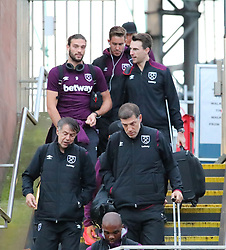 Slaven Bilic and Andy Carroll  and The West Ham team arrive at Piccadilly Train Station in Manchester ahead of their match against Burnley