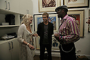 Jo Wood,  Ty Wood and Orlando Hamilton, Ronnie Wood, private view. Scream, 34 Bruton Street, London, W1, 23 August 2006. ONE TIME USE ONLY - DO NOT ARCHIVE  © Copyright Photograph by Dafydd Jones 66 Stockwell Park Rd. London SW9 0DA Tel 020 7733 0108 www.dafjones.com