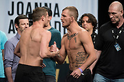 DALLAS, TX - MAY 12:  (L to R) Chas Skelly faces off with Jason Knight during the UFC 211 weigh-in at the American Airlines Center on May 12, 2017 in Dallas, Texas. (Photo by Cooper Neill/Zuffa LLC/Zuffa LLC via Getty Images)  ***Local Caption***  Chas Skelly; Jason Knight