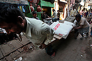 Daily life in the Dharavi slum in Mumbai, India.  The Dharbi slum is one of the largest in India and contains an entire ecosystem that offers residents the ability to never leave.