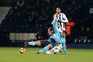 Fernando Llorente of Swansea city is tackled by Jonas Olsson of West Bromwich Albion. Premier league match, West Bromwich Albion v Swansea city at the Hawthorns stadium in West Bromwich, Midlands on Wednesday 14th December 2016. pic by Andrew Orchard, Andrew Orchard sports photography.