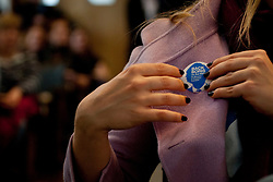 """© licensed to London News Pictures. London, UK 10/04/2012. A Boris Johnson supporter is placing a """"Back Boris"""" badge on her coat, while Boris Johnson explaining his 9 Point Plan for Greater London as he launches his campaign to be Mayor of London again, at Duke Street Church in Richmond, this noon (10/04/12). Photo credit: Tolga Akmen/LNP"""