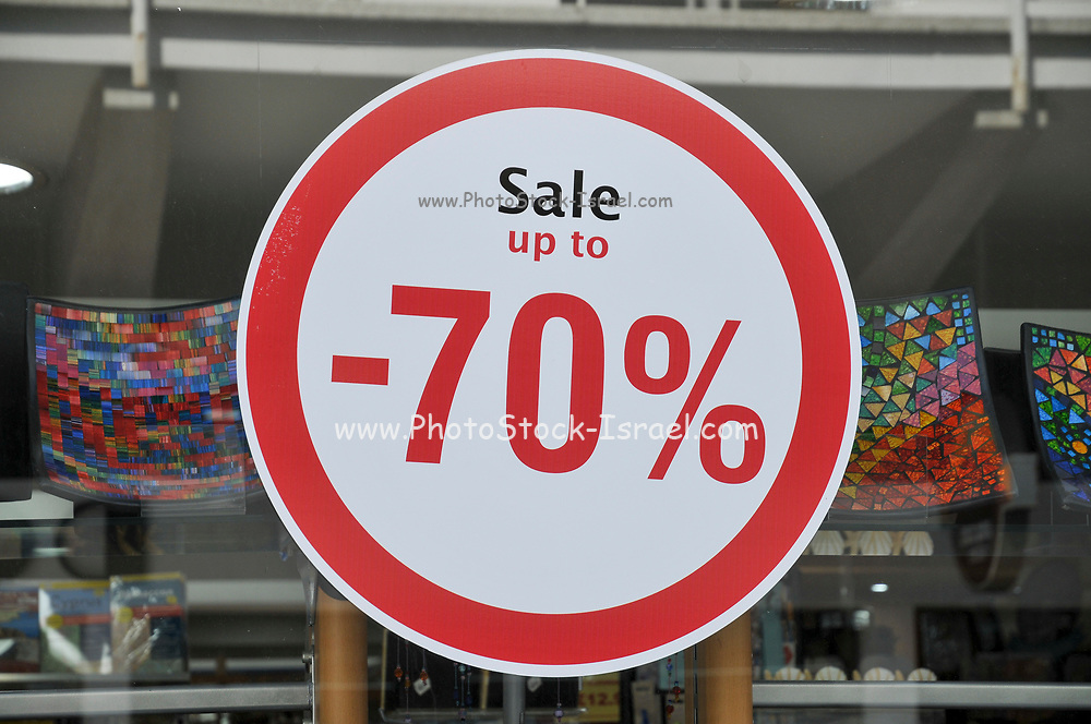 70% sale sign resembling a traffic sign