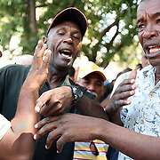 """Baseball fans excitedly argue in the Parque Central, in Havana, Cuba.  Fanatics of the game gather everyday in the """"esquina caliente"""" (hot corner) to talk (and argue) about """"pelota"""" (baseball) and their favorite teams.  ltqmb CUBA: HOT CORNER"""