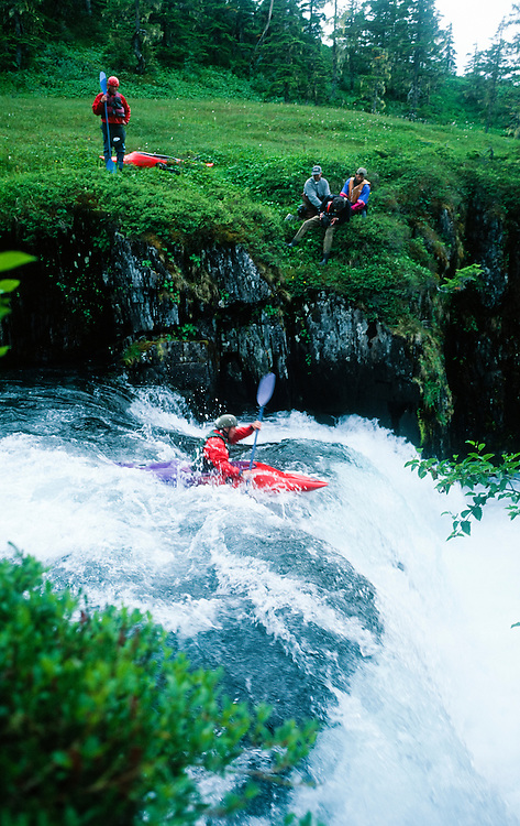 Alaska. Whitewater Kayaking . Man going over waterfall.