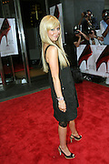 Ashley Tisdale posing before entering the 'The Devil Wears Prada' premiere at the AMC LOEWS in Lincoln Square, New York, USA, on Monday, June 20, 2006. **ITALY OUT**