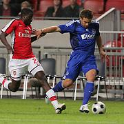 NLD/Amsterdam/20080808 - LG Tournament 2008 Amsterdam, Ajax v Arsenal, Emmanuel Eboue in duel met Miralem Sulejmani