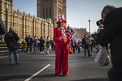 March 29, 2019 - London, England, U.K. - A Brexit supporter in fancy dress waves a flag outside Parliament during a Leave Means Leave rally. British MP's have voted to reject Prime Minister May's withdrawal agreement for a third time today. (Credit Image: © Rob Pinney/London News Pictures via ZUMA Wire)