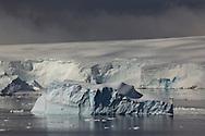 Icebergs in the water along the coast of Peter 1 Øy, Phantom Coast, Bellingshausen Sea, West Antarctica